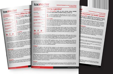 Business Tax Insider magazine holding iPad tablet paper magazine